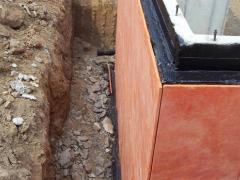 Exterior basement insulation