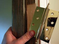 Install the hinges on the door frame