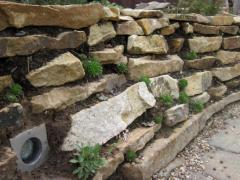 A retaining wall of natural stone