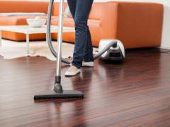 Clean the parquet floor with a vacuum cleaner