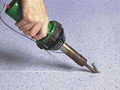 The installation of linoleum by hot welding
