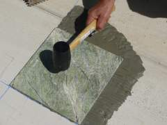 Self-laying marble tiles