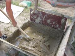 Knead the mortar for laying bricks