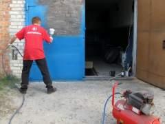 Paint the garage door with spray