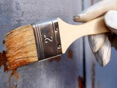 Paint the metal surface with a brush