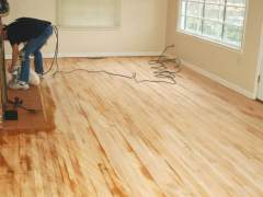 Sanding the floor made of natural wood