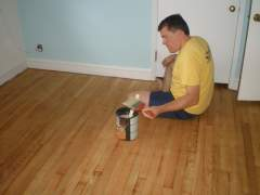Self-treatment of wooden floor protective agents