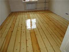 Hardwood floors after sanding, polishing and applying protective coatings