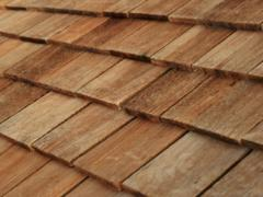 Wooden shingles. Expensive but effective materials
