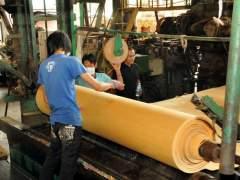 Manufacture of veneer sheets of natural wood
