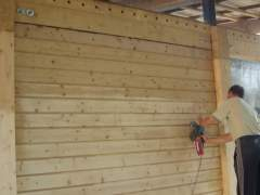 Preparation of wooden houses to paint